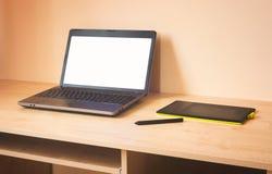 Ordenador portátil y tableta de gráficos Imagen de archivo libre de regalías