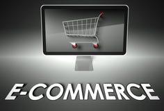 Ordenador y carro de la compra con el comercio electrónico, asunto Fotos de archivo