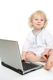 Ordenador y niño Imagen de archivo