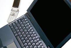 Ordenador y teléfono celular Foto de archivo
