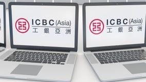 Ordenadores portátiles con industrial y Commercial Bank del logotipo de China ICBC en la pantalla Editorial conceptual de la info libre illustration