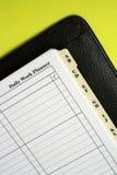 Ordene: Planificador diario del trabajo Fotografía de archivo
