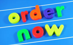 Order. Now colorful message on magnetic board Stock Image