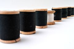 Order. Array of the spools with black and white threads Stock Photo