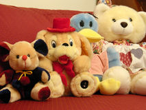In Order. A bunch of cuddly toys sitting on the sofa in nicely order stock photo