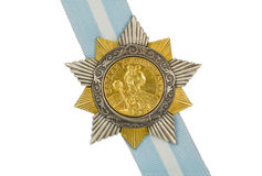 Order of Bohdan Khmelnytsky I degree. On the ribbon on a white background royalty free stock photo