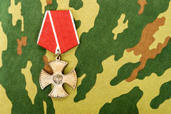 Order of bravery on the camouflage background. SAMARA, RUSSIA - APRIL 20, 2016: Order of bravery on the camouflage background Stock Photos