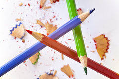Order and chaos. Three pencils forming triangular with splinters below Stock Photography