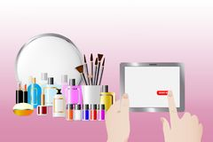 Order cosmetic services and accessories concept. Cosmetic accessories standing in front of a mirror on the pink background. Female hands are holding a tablet and Royalty Free Stock Photos