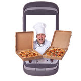 Order delivery pizza. Cook holds a giant phone communicator, computer Royalty Free Stock Photos