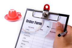 Order form in hand. Royalty Free Stock Photos