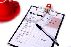 Order form and a pen. Stock Photos