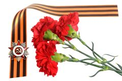 Order of Great Patriotic war on Saint George ribbon as frame with cloves Stock Images
