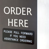 Order Here Sign. At a drive-through Royalty Free Stock Image