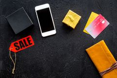 Order new year 2018 present with sale with credit card and mobile on black table background top view mock up Royalty Free Stock Photo