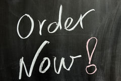 Order now. Chalk drawing - Order now written on chalkboard Stock Photos
