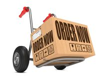 Order Now - Cardboard Box on Hand Truck. Stock Photos