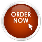 Order now premium brown round button. Order now isolated on premium brown round button abstract illustration Royalty Free Stock Images