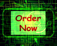 Order Now On Phone Shows Buying Online In Web Stores Royalty Free Stock Photos