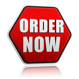 Order now on red hexagon banner Stock Image