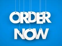 Order now - word hanging on orange background Stock Photo