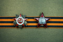Order of the Patriotic War and of the Red Star.. Order of the Patriotic War and the Order of the Red Star on St Georges ribbon on a bronze background Stock Photography