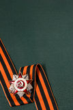 Order of the Patriotic War and St. George ribbon on green backgr Stock Photos