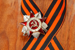 Order of the Patriotic War in St. George's Ribbon on a wooden background Stock Image