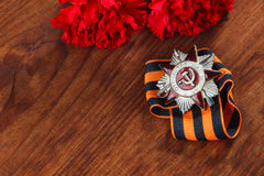 Order of the Patriotic War in St. and Symbols of Victory in Great Patriotic War 1941-1945. Symbols of Victory in Great Patriotic War 1941-1945 on wooden table Royalty Free Stock Photo