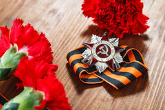 Order of the Patriotic War in St. and Symbols of Victory in Great Patriotic War 1941-1945. Symbols of Victory in Great Patriotic War 1941-1945 on wooden table Royalty Free Stock Photos