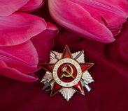 Order of Patriotic Ward and flower. Stock Image