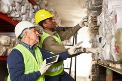 Order picker with tablet in the carpet warehouse stock images