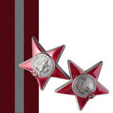 Order of Red Star. Isolated. Two Soviet awards of a Red Star with a medal tape on a white background. It is isolated, the worker of paths is present Royalty Free Stock Images