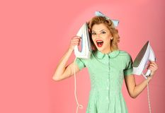 Order services, wife, gender equality. Housekeeper in uniform with iron, household. Pinup woman hold iron, retro style, maid. Everyday life, housework. Retro royalty free stock photos