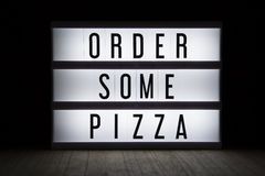 Order some pizza. `Order some pizza` text in lightbox stock illustration