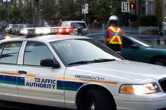 Order on the street. Police car regulatin traffic on Vancouver street Royalty Free Stock Photos