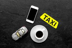 Order taxi online by mobile phone. Black background top view copyspace Royalty Free Stock Image