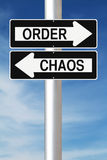 Order Versus Chaos. Modified one way street signs indicating Order and Chaos Stock Photos