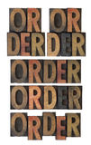 Order word in vintage wood type stock photography