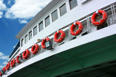 Ordered life rings on ferryboat Stock Photo