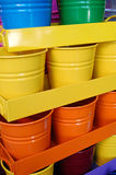 Ordered pails and containers. Ordered and coloured pails, containers and metal flowers useful as gardening tools Stock Photo