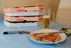 Ordered pizza. Pizza, delivered home, and a glass of bear Royalty Free Stock Photo