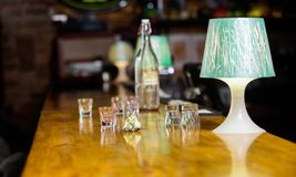 Ordering drinks in bar. Purchase and payment. Cash money concept. Leave tips for bartender. Tip given to waiter. Crumpled money cash at bar counter. Empty stock image