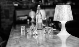 Ordering drinks in bar. Purchase and payment. Cash money concept. Leave tips for bartender. Tip given to waiter. Crumpled money cash at bar counter. Empty royalty free stock photos