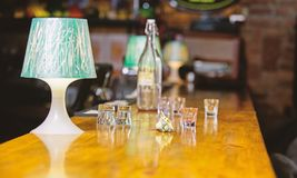 Ordering drinks in bar. Purchase and payment. Cash money concept. Leave tips for bartender. Tip given to waiter. Crumpled money cash at bar counter. Empty stock photos
