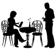 Ordering. Editable vector silhouette of a woman ordering food and drink from a waiter at a cafe or restaurant with all objects as separate elements Stock Images