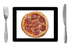 Ordering food online. With tablet pc stock image