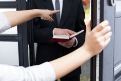 Ordering Jehovah's witness to go out Royalty Free Stock Images