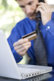 Ordering medicine online. Man purchasing pharmaceuticals online using his credit card Stock Photography