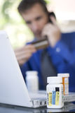 Ordering medicine online. Man ordering medicine online Royalty Free Stock Photo